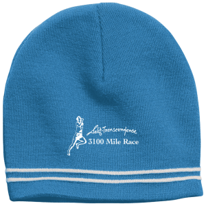 "A blue beanie with graphic of person running and text: ""Self-Transcendence 3100 Mile Race"""